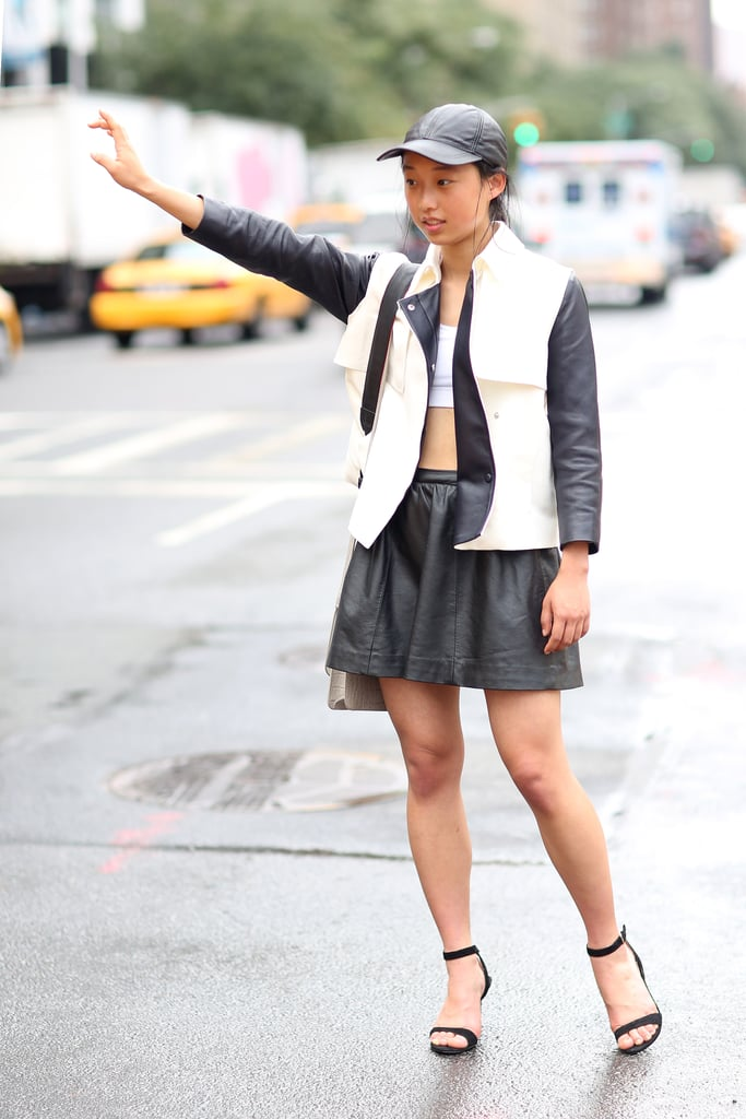 This styler pared down her crop top with a fit-and-flare skirt and a sporty leather cap. Source: Greg Kessler