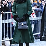 In Jan., the Duchess of Cambridge walked the cobbled streets of Stockholm in a forest green Catherine Walker coat, Russell & Bromley boots. She carried a black Mulberry Mini Seaton bag.