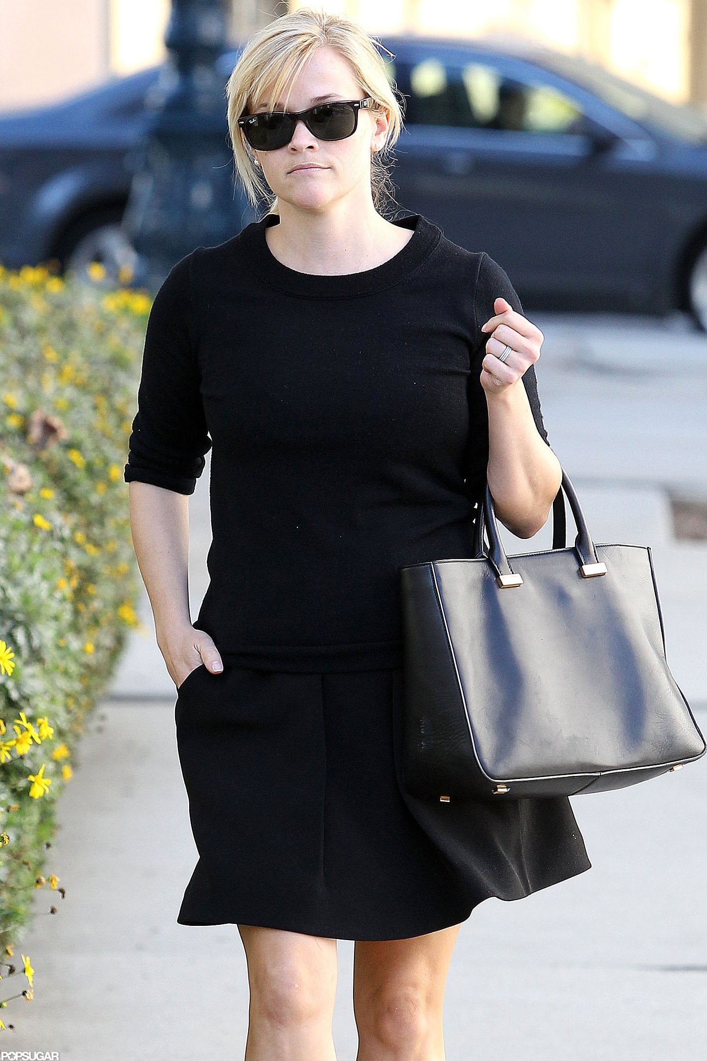 Reese Witherspoon sported black shades.