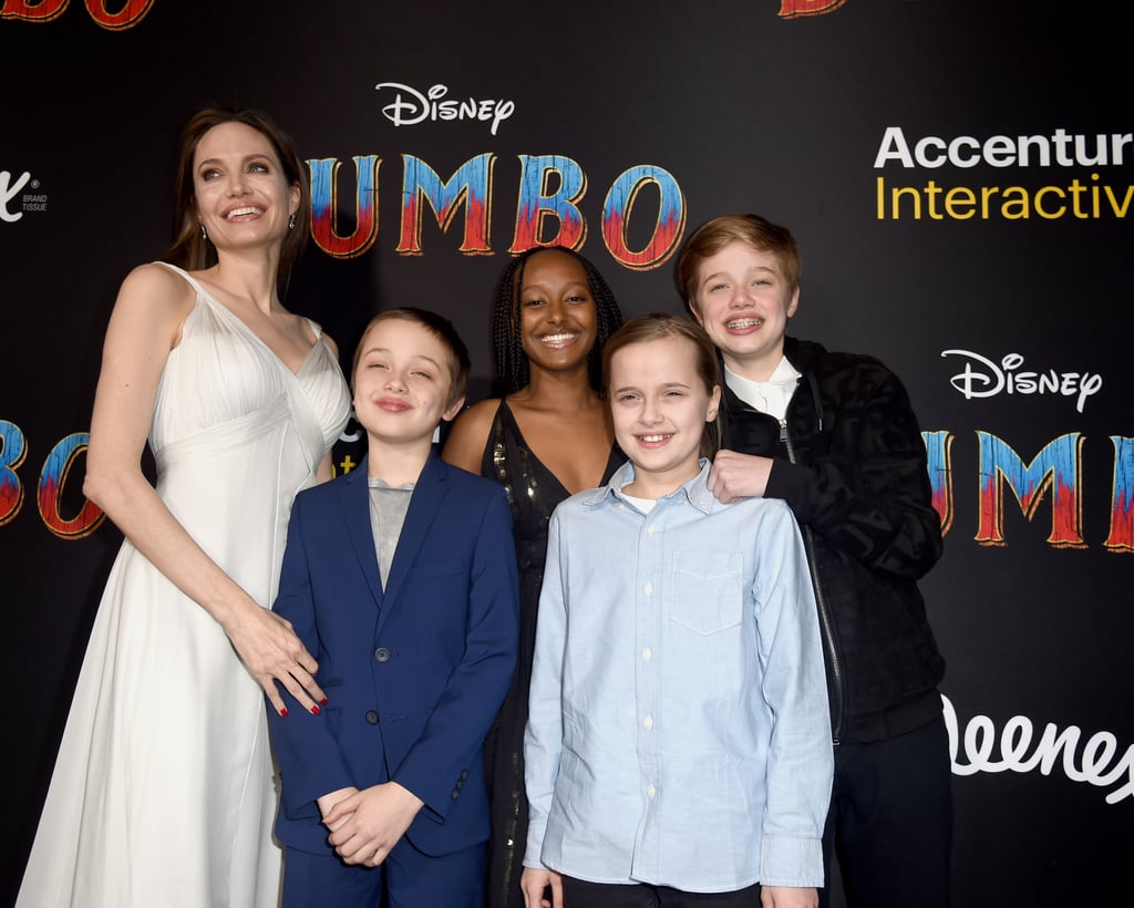 Angelina Jolie and her four youngest kids had a movie night out on March 11 to celebrate the Dumbo premiere in LA. Zahara, 14,  Shiloh, 12, Vivienne, 10, and Knox, 10, were all smiles as they accompanied their mom during a rare red carpet appearance. In fact, Angelina's kids even appeared to burst into giggles along the way, causing Mom to laugh right along with them. Perhaps they're practicing poses for Angelina's own Maleficent: Mistress of Evil premiere in October? This is the second film event Angelina and her children have enjoyed in the past two weeks. On Feb. 25, the actress brought all the kids, including sons Maddox, 17, and Pax, 15, to an NYC showing of The Boy Who Harnessed the Wind. This is quite the cultured crew! Ahead, see more photos from their night on the red carpet.
