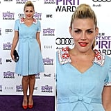 Busy Philipps looked ultra sweet in a retro-inspired baby blue dress with a red beaded collar. She put her hair in a perky ponytail and accessorized with red pumps. It's a girlie look, particularly with the bow-tied front. We love the red lip!