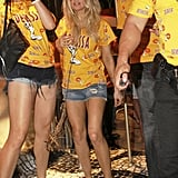 Fergie partied in a yellow shirt.