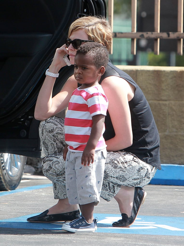 Charlize Theron crouched down next to Jackson.