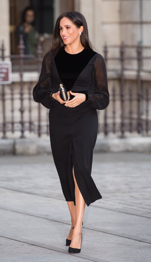 """Meghan, too, is a fan of sheer — see-through sleeves in particular. She wore a sophisticated Givenchy dress with sheer panels and billowy sleeves for her first solo royal engagement at the opening of the """"Oceania"""" art exhibit back in September of 2018."""