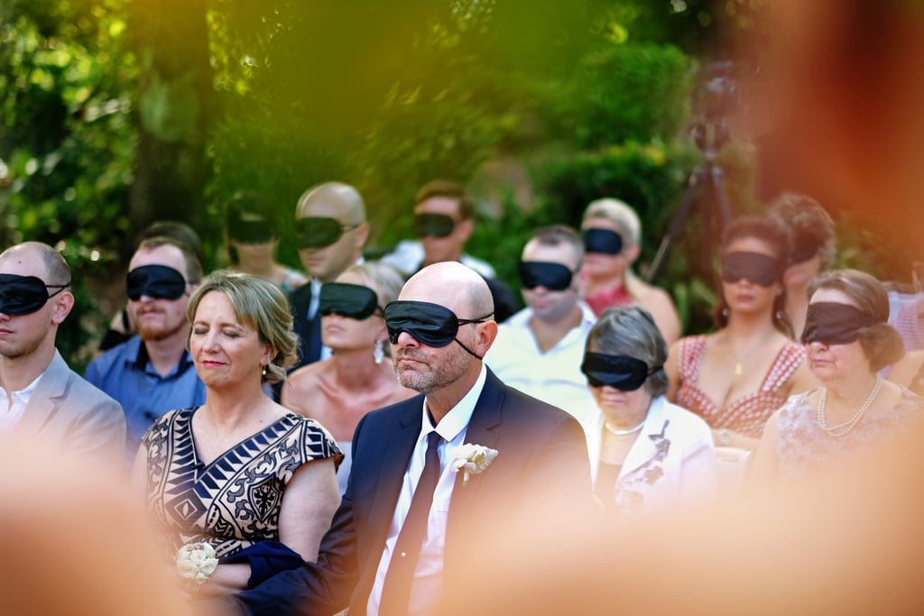 "When Robbie Campbell set out to marry Stephanie Agnew in Australia, he was determined to make the day as perfect as possible. To do that, he blindfolded all 54 of his wedding guests so they could experience their wedding the exact same way as his bride, Stephanie, who went blind shortly before meeting Robbie. James Day, a local photographer, captured the most precious moments of the day, and the photos are the definition of stunning.  According to James's Facebook post, Robbie made an announcement to the guests right away, saying: ""When we lose one of our senses, the others become heightened. This allows us to experience something as beautiful as these vows in a totally unique way. Today, we get to experience them from Steph's perspective."" ""When we lose one of our senses, the others become heightened. This allows us to experience something as beautiful as these vows in a totally unique way."" Although the request was certainly out of the ordinary for attendees, it meant a lot to Robbie as well as Stephanie's mom, who, like her daughter, went blind from cone-rod dystrophy. ""I couldn't control my emotions as she walked down the aisle,"" Robbie told The Daily Mail. ""She looked like a true princess bride in the dress. The blindfolds were received well by the guests as they were experiencing that moment in the same way Steph and her mum, who is also blind, were experiencing it."" For Stephanie, who's never seen her husband, the moment was one she'll never forget.  ""I've never seen him. I know his build,"" Stephanie said. ""He is 6 foot 4 inches and I am 5 foot 4 inches, so he is a lot taller than me. And I know he has broad shoulders, but other than that I have to rely on descriptions. Everyone has hurdles so it's important to dig deep within yourself and understand that life can be hard but there are always ways to deal with things."" Scroll through to get a look at the photos from this unforgettable day, and try not to tear up in the process.       Related:                                                                                                           These Kiddos Caught on Camera at Weddings Are Hysterical — and So Typical"