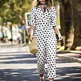 The ultimate mood-booting outfit: head-to-toe polka dots with yellow heels and a straw bag.
