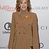Jane Fonda wore a brown pantsuit to the event.