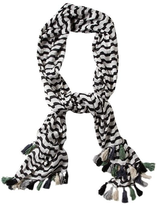 Wrap yourself in a comfy stripe-laden jersey scarf. Michael Stars Catch a Wave Scarf ($48)