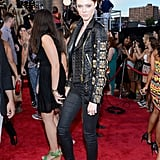Coco Rocha took her look to rocker heights in a black embellished leather Fausto Puglisi biker jacket and slim black jeans.