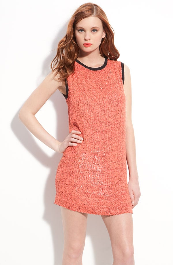This sparkly shift dress would look great with a white blazer.  Robert Rodriguez Sleeveless Sequin Shift Dress ($725)