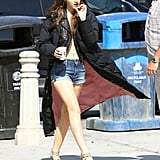 Emma Watson showed off her abs and a temporary back tattoo on the LA set of Sofia Coppola's The Bling Ring.