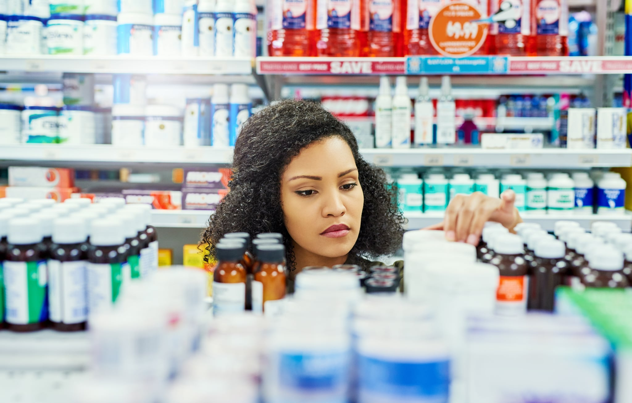 Cropped shot of a female customer in a pharmacy