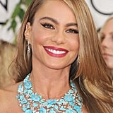 Sofia Vergara accessorized her strapless neckline with a can't-miss, gorgeous floral bib Lorraine Schwartz necklace.