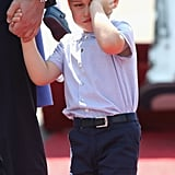 Prince George flashed his signature unimpressed face when he landed in Berlin to tour the city with his family.