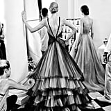 A Rami Al Ali model shows off the dramatic back to her gown.