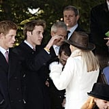 Prince William played with Zara Phillips's hat alongside his brother, Prince Harry, in 2004.