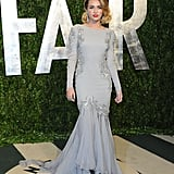 We know what you're thinking. Is this really Miley Cyrus?! Yep, Miley wowed us in this dove-grey, long-sleeved gown by Roberto Cavalli with a silk waterfall mermaid train back in 2012. Could we see more of this Miley, please?