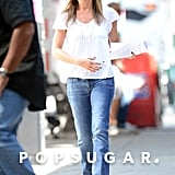 Jennifer Aniston smiled on her way to work on July 31.
