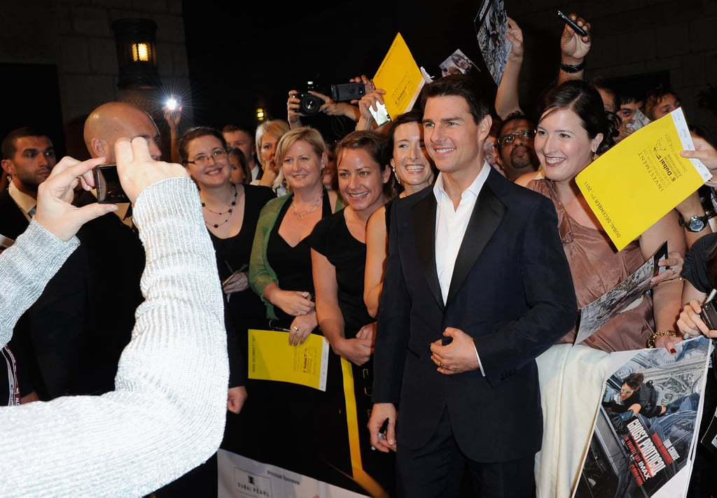 Tom Cruise took pictures with fans.