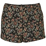 Pair these Topshop Tapestry Shorts ($64) with black tights, ankle booties, and a chunky knit sweater.