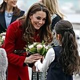 Kate smiled at a little girl during a UNICEF visit in Denmark in November 2011.