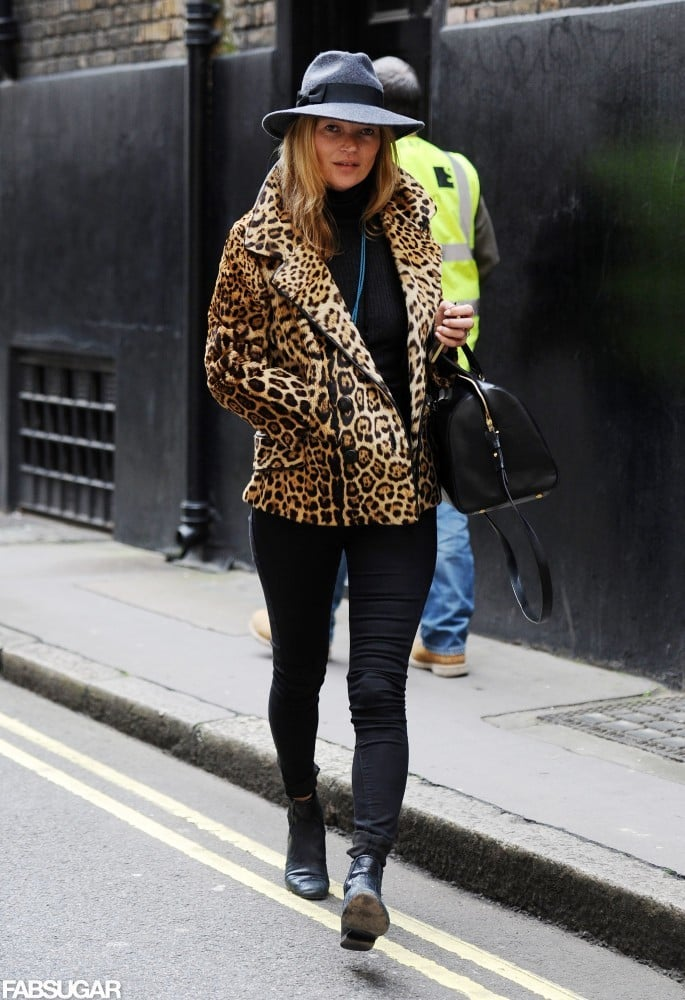Start with an all-black base, then pop on a leopard-print coat, black ankle boots, and a chic wide-brimmed hat. Shop her look below.