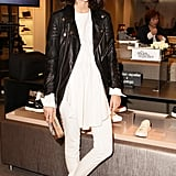 Leandra Medine kicked off her Superga collaboration in a leather jacket-topped white ensemble.