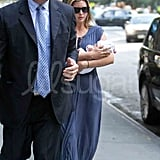 Ivanka Trump walking up to her new apartment with her baby.