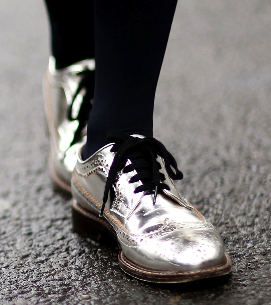 Metallic lace-up loafers put a jazzy pep in every step of this Fashion Week-goer's look.