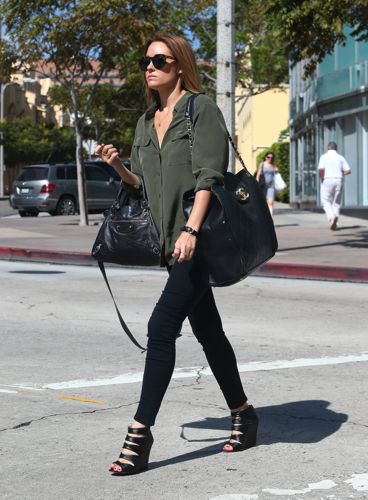 "Lauren Conrad had her hands full, carrying a Balenciaga and a Chanel bag, as she ran errands in Westwood, CA, yesterday. She's kicking off Fall on the West Coast after wrapping up Summer with a visit to NYFW. Lauren attended multiple shows including Kate Spade and Lela Rose, though she also had a lot to say about her own upcoming collections. LC said her latest line is ""more of a pulled-together look"" with pleated skirts, button-down tops, and print mixing. She's juggling designing duties with her website, and even recently hosted a live book club chat for Gone Girl."
