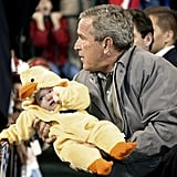 George W. Bush got in the Halloween spirit holding a duck-clad supporter in the final days of the 2004 presidential campaign.