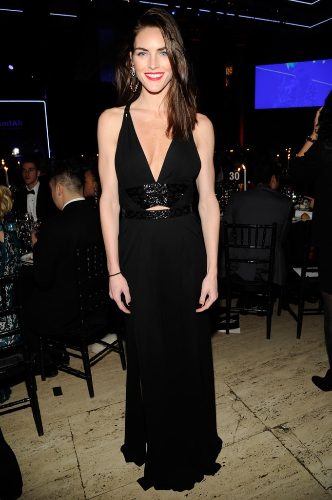 Hilary Rhoda attended the amfAR New York Gala in a black Roberto Cavalli gown with cutouts.