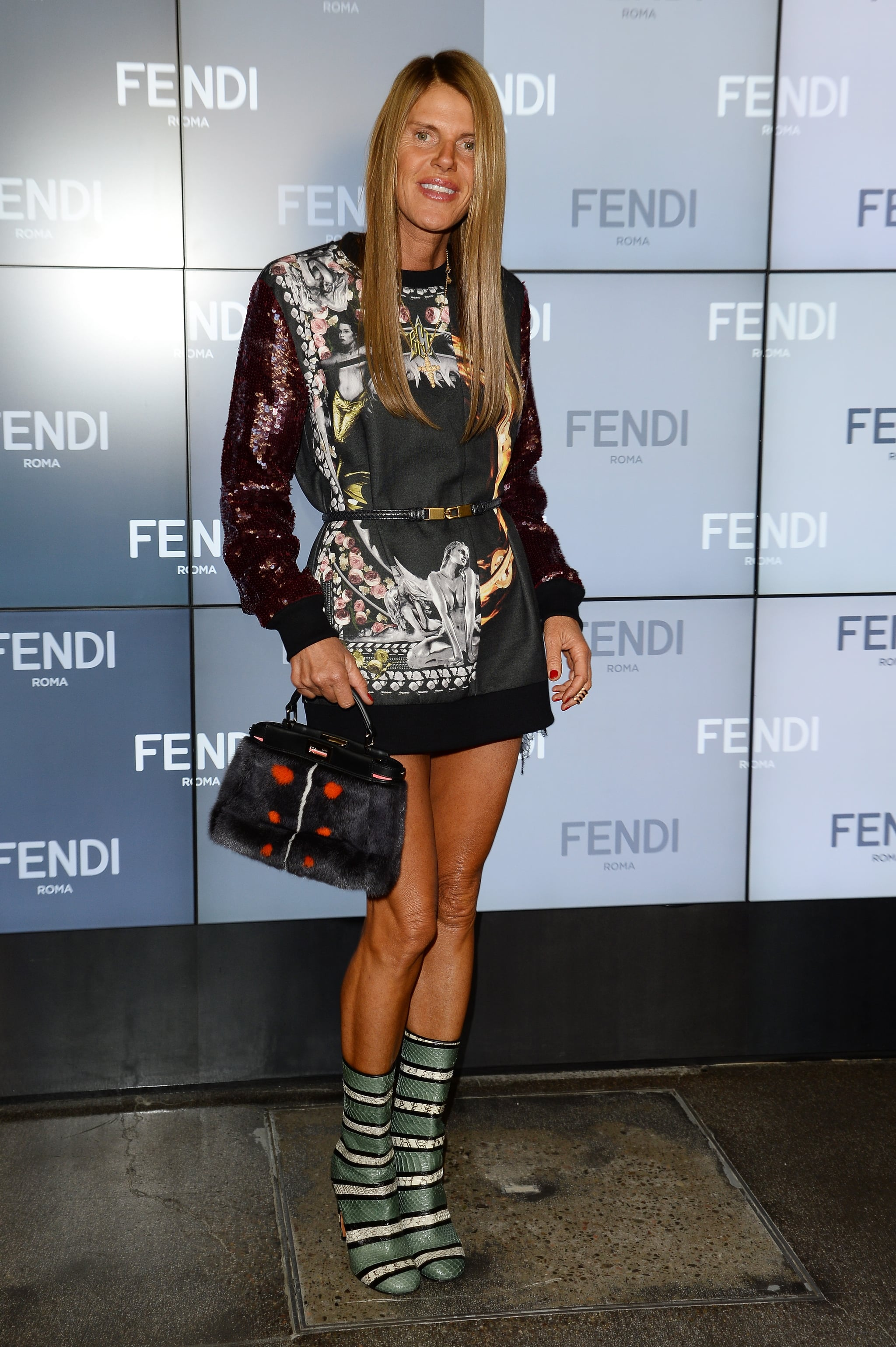 Anna Dello Russo mixed and matched like a pro in her bold bag and boots at the Fendi show.
