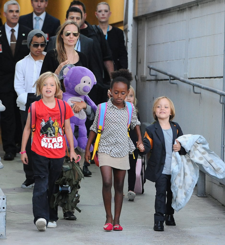 With a brood of six, Angelina Jolie can use all the help she can get. So when the family touched down in Sydney this week, we're sure she appreciated seeing Zahara grab Knox's hand for the walk out to their waiting car.