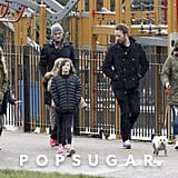 Chris Martin and Tim McGraw walked with their kids.