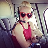 Pink flashed a peace sign from her helicopter in September. Source: Instagram user pink