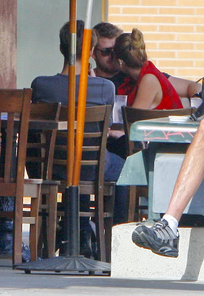 Miley Cyrus snuggled up to Liam Hemsworth while dining in LA in January.