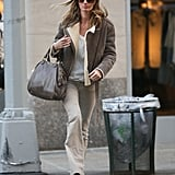 Gisele Bündchen bundled up in neutrals on a cold Winter day.