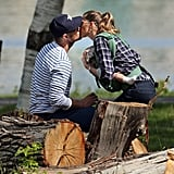 They've still got it! Good-looking power couple Tom Brady and Gisele Bundchen stole a kiss while hanging with their kids and dog in a Boston park onMay 19.