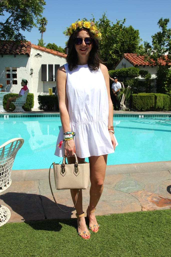 A white drop-waist dress was the foundation for a few festival-perfect accessories: a bright flower crown, a Henri Bendel bag and sunglasses, and embellished Zara sandals.