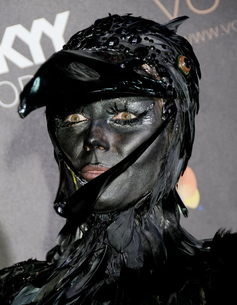 In 2009, Heidi, wearing ultralong lashes and dark face paint, created her interpretation of a black raven.
