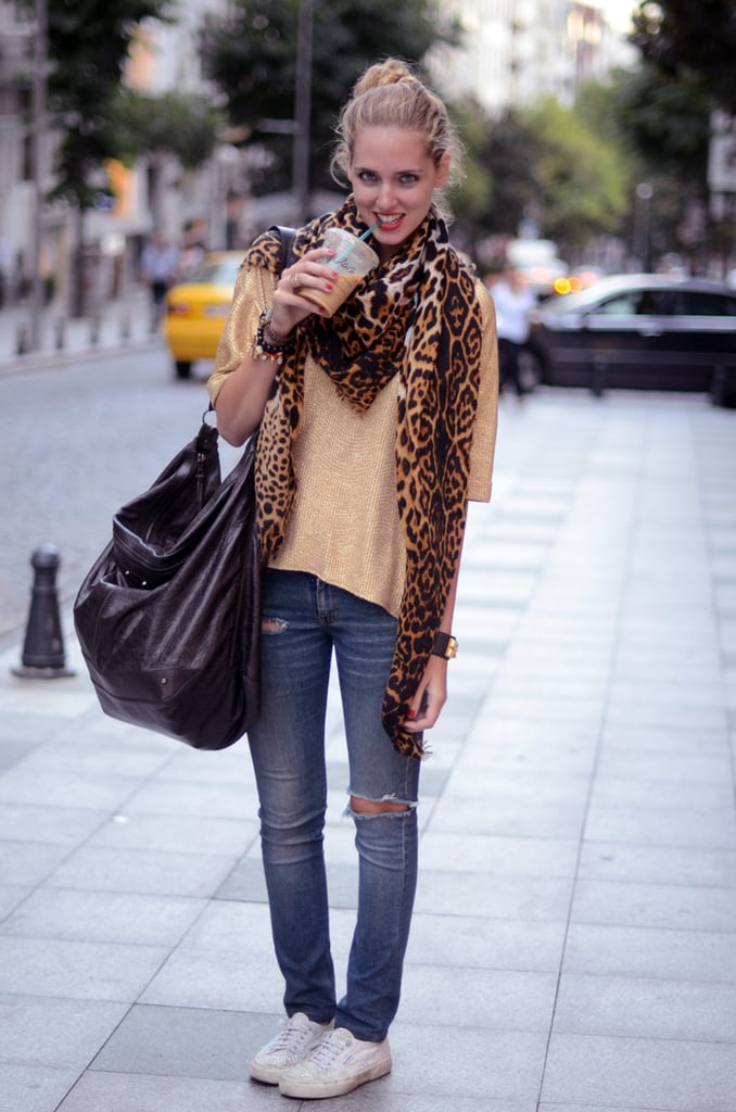 Distressed denim dressed down with casual kicks and a standout scarf — cute!  Photo courtesy of The Blonde Salad