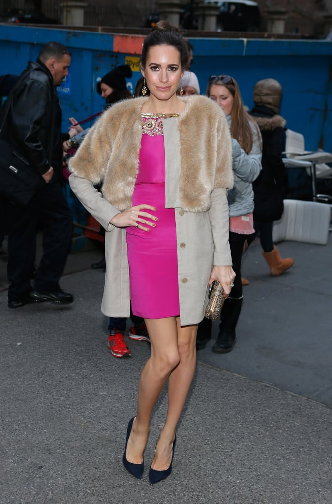 Pretty-in-pink Louise Roe topped her flirty sheath with a fur-trimmed camel coat during New York Fashion Week.