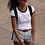 "Malia popped up in Philadelphia for the annual Made in America Festival in September 2016. The first daughter — who was spotted among the crowd while Travis Scott took the stage — wore denim cutoffs, a baseball cap, and a t-shirt that read, ""SMOKING KILLS."""