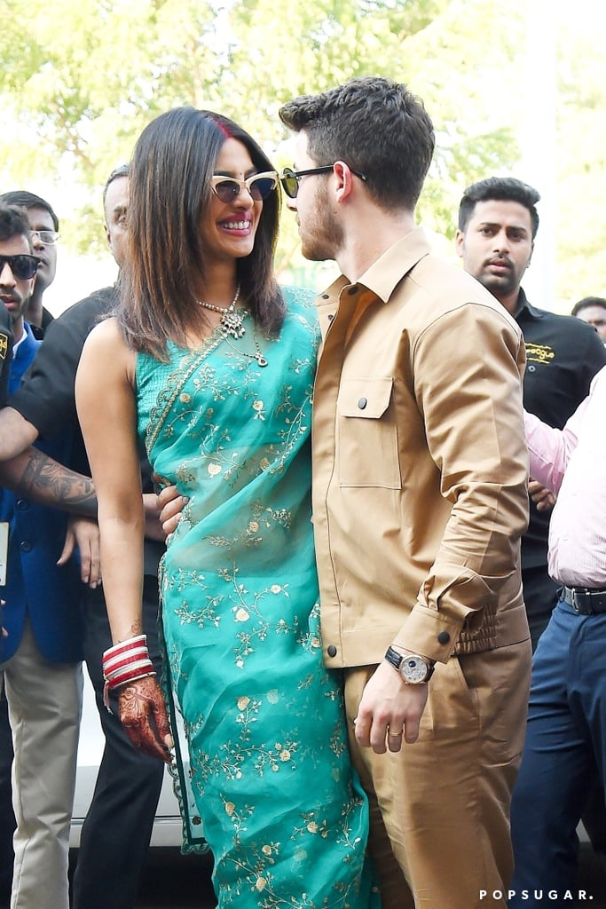 "Nick Jonas and Priyanka Chopra definitely have that newlywed glow! After tying the knot during a fun-filled weekend in Jodhpur, India, the couple made their first appearance as husband and wife on Monday. The 36-year-old actress wore a gorgeous turquoise sari, while the 26-year-old singer wore a tan jacket and trousers. He even showed off his new gold wedding band as he gave the photographers a thumbs up. The pair looked head over heels in love as they flashed huge smiles and stared into each other's eyes. We like to imagine Nick serenaded Priyanka with the Jonas Brothers' hit ""When You Look Me in the Eyes"" directly after this. The two have certainly had a whirlwind romance. News of their relationship first broke in May, and Nick popped the question two months later. During Priyanka's Vogue January cover interview, Nick's brother Joe revealed that the singer was pretty much smitten with Priyanka the moment he met her. ""I think she kind of knocked him off his feet,"" Joe said. ""He was just this little puppy dog."" When you know, you know, right? If you need us, we'll just be replaying ""Lovebug"" over and over as we look back at their swoon-worthy romance.       Related:                                                                                                           30 Times Priyanka Chopra and Nick Jonas Made Us Say, ""DAMN, They Look Good Together!"""