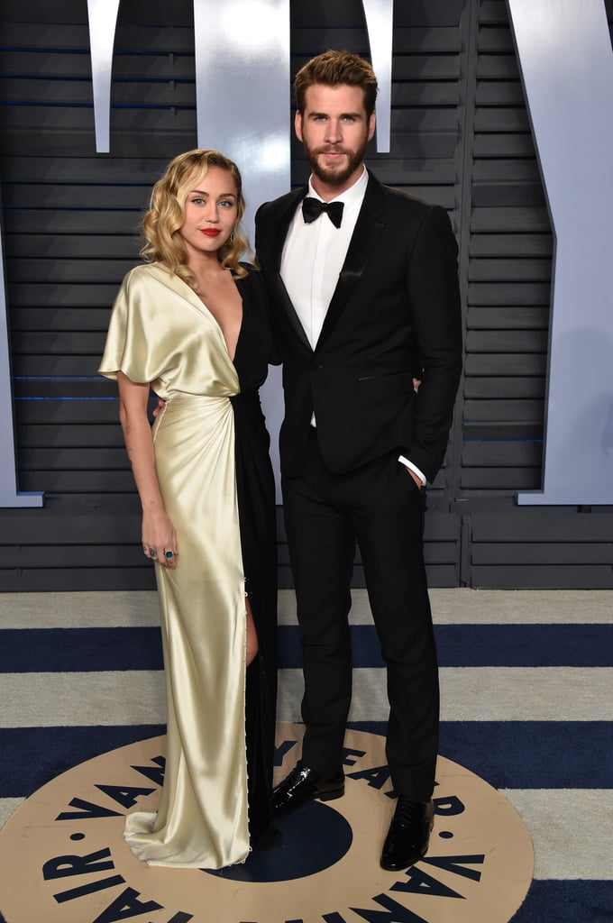 "Miley Cyrus and Liam Hemsworth have been through ups and downs throughout the years, but it seems as though they're in a great place right now. On Dec. 12, the 26-year-old ""Nothing Breaks Like a Heart"" singer stopped by The Howard Stern Show and chatted about the current status of her relationship with the Australian hunk. When asked whether Liam was her fiancé, Miley responded, ""Yeah, kind of-ish. My partner — I call him my survival partner now. And he thinks it's not romantic, but I learned that is why you pair up with someone, for survival."" The two have certainly depended on each other for support, especially recently when they lost their Malibu home in the 2018 Woolsey Fire. Miley also explained how Liam was able to save their animals from the fire. ""He was so incredible,"" she said. ""He got all the animals out in his truck. He put two pigs in crates, which I tell you is so hard. I said, 'How did you get them out?' And he said the only thing he could do was get a really powerful hose and spray them in the a**. So he just chased the pigs into a crate, which was genius."" And to show her appreciation, Miley said she gave Liam ""a lot of action"" for his heroic deed. The duo first met on the set of 2007's The Last Song and began dating. Eventually, they had planned on getting married, but called off their engagement in 2013. Two years later, they got back together and have remained a couple ever since. They even recently shut down rumours of them splitting up with a hilarious video. You have to have a lot of faith and trust in someone to call them your ""survival partner."" So, yeah, it sounds like they're going pretty strong. See some of their sweetest photos from this year ahead before checking out even more of their cutest pictures over the years."