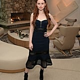 Wearing a black strapless dress and boots at the launch of Proenza Schouler's fragrance Arizona in 2018.