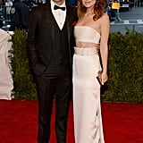 Olivia Wilde looked toward the future, not the past, as she flashed some midriff in Calvin Klein per one of Spring's biggest trends. Fiancé Jason Sudeikis did his punk part, though, rocking sneakers rather than a formal lace-up.