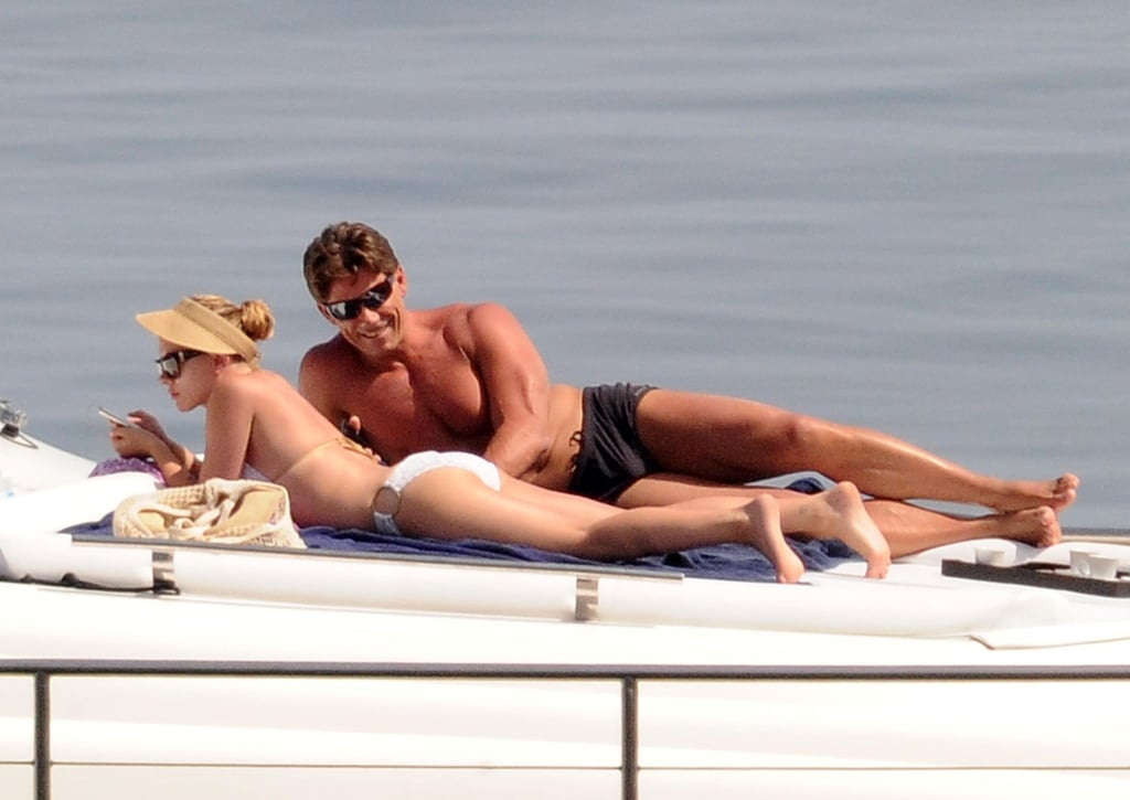Scarlett Johansson got her tan on in a white bikini while floating around Sicily in July 2012.