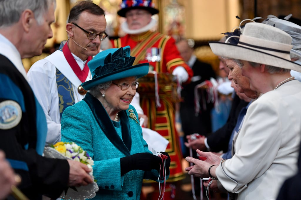 "If you weren't one of the lucky 91 men or 91 women to receive a bag of money from Queen Elizabeth II, you might be wondering why. Well, the tradition of distributing ""Maundy money"" dates all the way back to the 13th century, which is celebrated every year on the Thursday before Easter Sunday. The queen hands out two small leather purses to recipients, and the gifts inside reflect how many years the queen has lived (she turned 91 on April 21, 2017). The first purse, which is red, contains a £5 coin to commemorate the Centenary of the House of Windsor and a 50p coin in honor of Sir Isaac Newton. The second purse is white, and is filled with Maundy coins, the amount of which add up to the queen's age.  Each recipient of special Maundy money from The Queen today will be given two leather purses, one red and one white #RoyalMaundy pic.twitter.com/d5lqTD6SGo — The Royal Family (@RoyalFamily) April 13, 2017   According to the Royal Mint, ""It seems to have been the custom as early as the thirteenth century for members of the royal family to take part in Maundy ceremonies, to distribute money and gifts, and to recall Christ's simple act of humility by washing the feet of the poor."" The 182 people who received the bags from Queen Elizabeth II were all recommended by clergy members, and retired pensioners. This year's event drew thousands of citizens to Leicester Cathedral who were eager to catch a glimpse of the Queen, who arrived in a bright turquoise suit and matching hat. After the service inside, she and Prince Philip posed with Yeoman of the Guard and later greeted attending veterans."